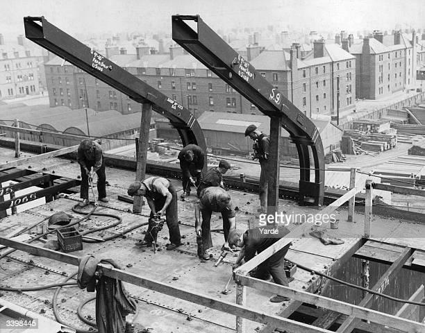 Riveters at work constructing the liner 'Strathallan' at the VickersArmstrong yards at Barrowin Furness