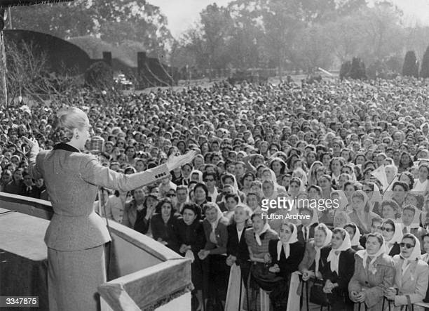 Eva Peron who organised women workers and secured votes for women addresses a crowd of women