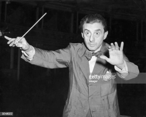 British conductor Sir John Barbirolli conducting the Halle orchestra at the 59th Henry Wood Promenade Concerts at the Royal Albert Hall.