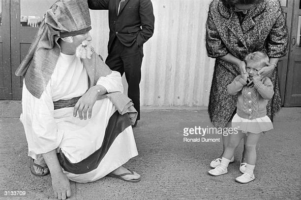 A young girl with her mother and a performer in a religious play during a Jehovah's Witness convention at Twickenham rugby ground