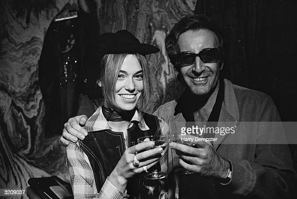 British actor and comedian Peter Sellers and his wife Miranda Quarry make a champagne toast after their wedding ceremony at Caxton Hall
