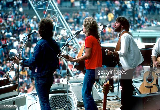 Folk rock band America perform live on stage in Central Park New York on 24th August 1975 Left to Right Dan Peek Gerry Beckley and Dewey Bunnell