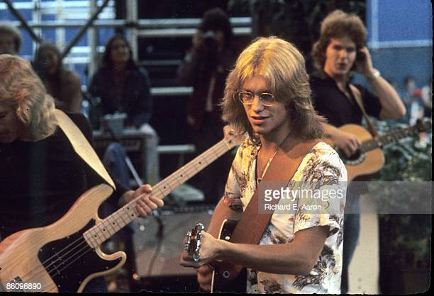 Folk rock band America perform live on stage in Central Park New York on 24th August 1975 Left to right Gerry Beckley and Dan Peek behind