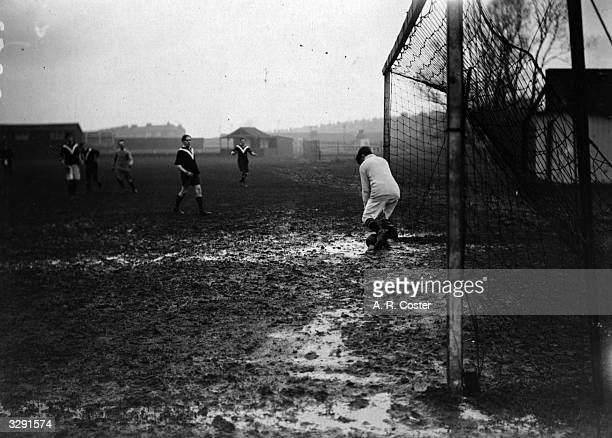 A Christmas Eve football match in progress in the mud between Topical Press and Photo Press at Nunhead