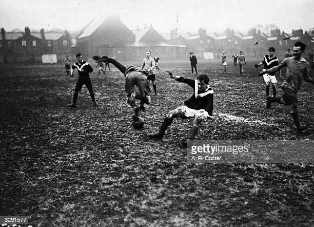 Christmas Eve football match in progress in the mud between Topical Press and Photo Press at Nunhead.
