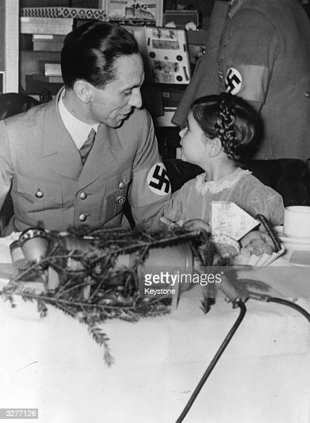 Dr Joseph Goebbels the German minister of propaganda with his daughter Hilde during a children's party