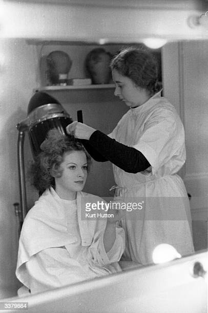 Irish actress Maureen O'Hara submits to the attentions of a hairdresser for her part in the film adaptation of 'Jamaica Inn' Original Publication...