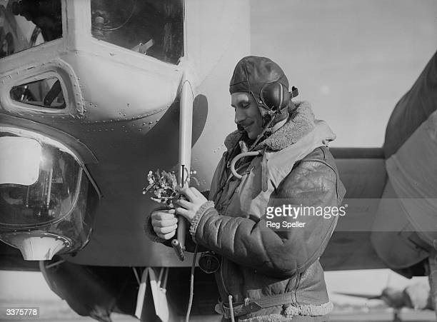 A bomber pilot of the British Coastal Command acknowledges the festive season despite World War II by affixing a sprig of mistletoe to his aircraft...
