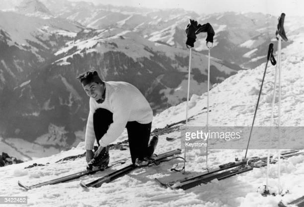 Karim Al Hussaini Shah Aga Khan IV fastening a ski during a skiing trip in Kitzbuhel