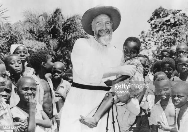 French missionary Father Durand with parishoners in Mongali, near Brazzaville in the Belgian Congo, now the Republic of Congo.