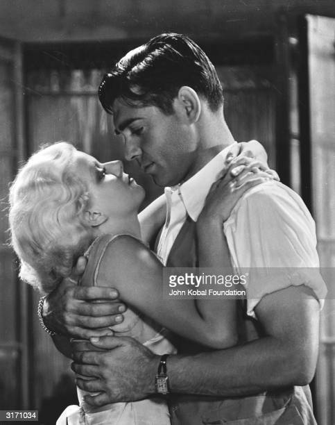 Dennis Carson played by Clark Gable embraces the fugitive Vantine played by Jean Harlow in a scene from 'Red Dust' directed by Victor Fleming