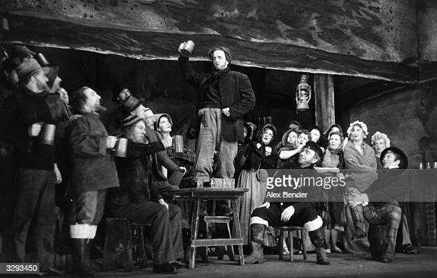 A scene from Benjamin Britten's new opera 'Peter Grimes' at the Sadler's Wells theatre in London with tenor Peter Pears as Grimes Original...