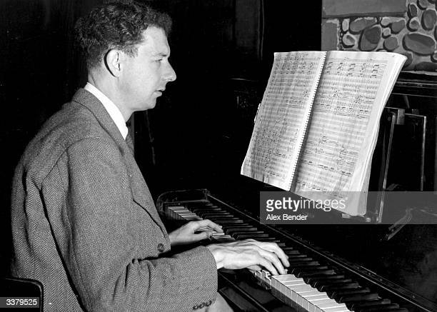 British composer Benjamin Edward Britten Baron Britten of Aldeburgh reading music from his latest opera 'Peter Grimes' Original Publication Picture...