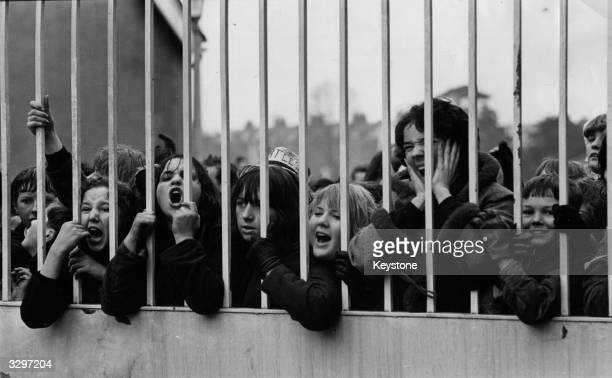 A group of Beatles fans waiting for a glimpse of their idols outside ABC Television Studios in Teddington where they are working on a new film This...