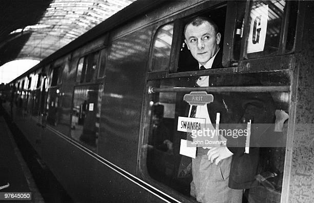 Chelsea football manager Tommy Docherty on a train to Swansea