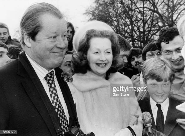 The 8th Earl Spencer with his wife Raine formerly Lady Lewisham and his son Charles Viscount Althorp on a visit to Buckingham Palace Raine Spencer is...