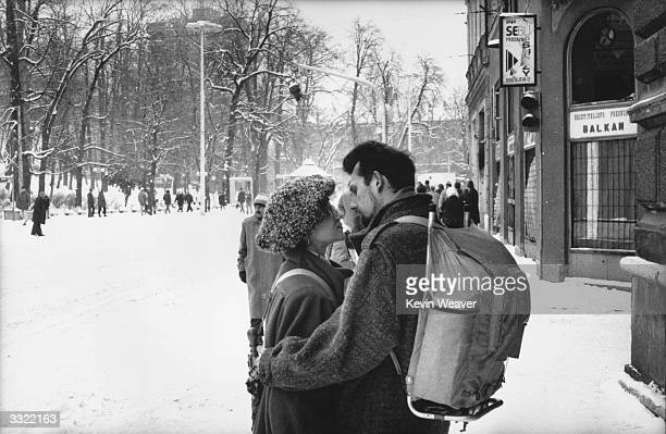 Couple share an intimate moment on a street in Sarajevo after the ceasefire agreement following civil war in Yugoslavia.