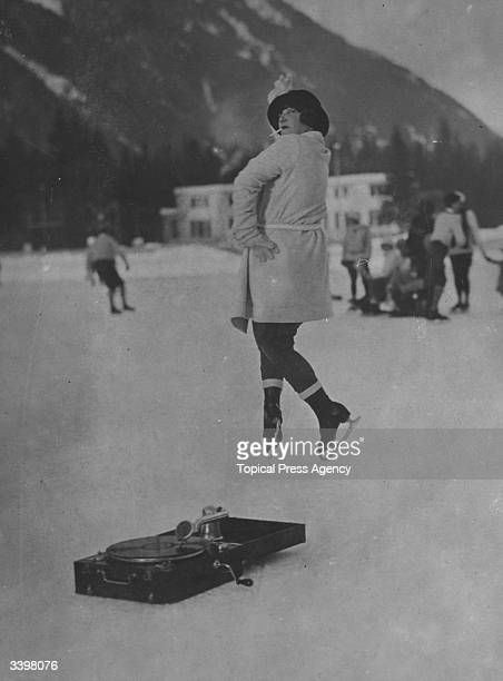 A woman dancing to a gramophone in Chamonix France
