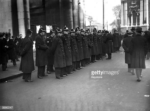 Officers of Dublin's Metropolitan Police line up to keep crowds in order during Cosgrave's election meeting at College Green in Dublin.