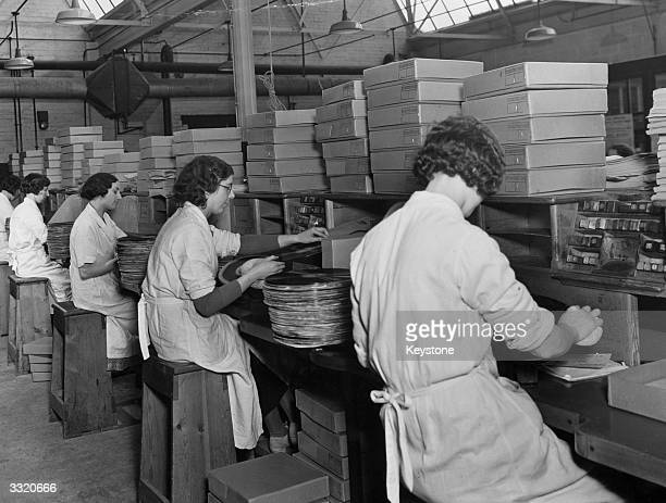 Factory workers busy packing gramophone records of the King George V's Christmas broadcast his last speech to his people