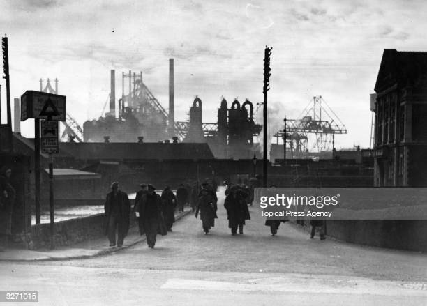 Workers leaving the Steel Company of Wales works at Port Talbot at the end of the afternoon shift