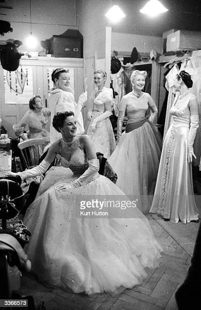 Models wearing dresses by couturier Sir Norman Hartnell in his dressing-room. Original Publication: Picture Post - 6392 - Hartnell And The Coronation...