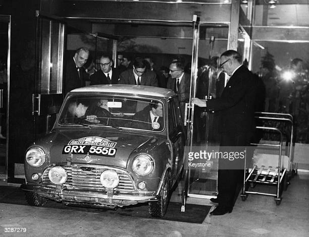 British cars welcomed back at London airport having taken part in the Monte Carlo Rally Timo Makinen seen driving his disqualified Mini Cooper into...
