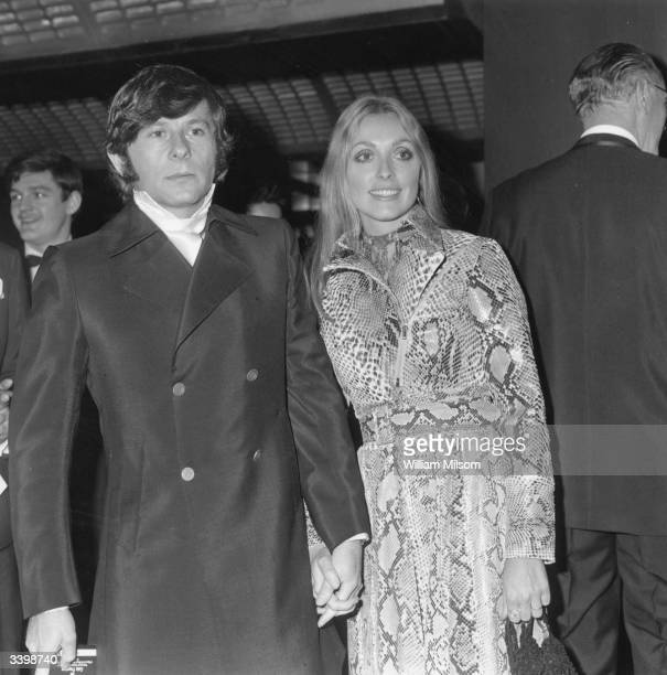 Polish film director Roman Polanski arriving at the premiere of his film 'Rosemary's Baby' with his second wife American film actress Sharon Tate