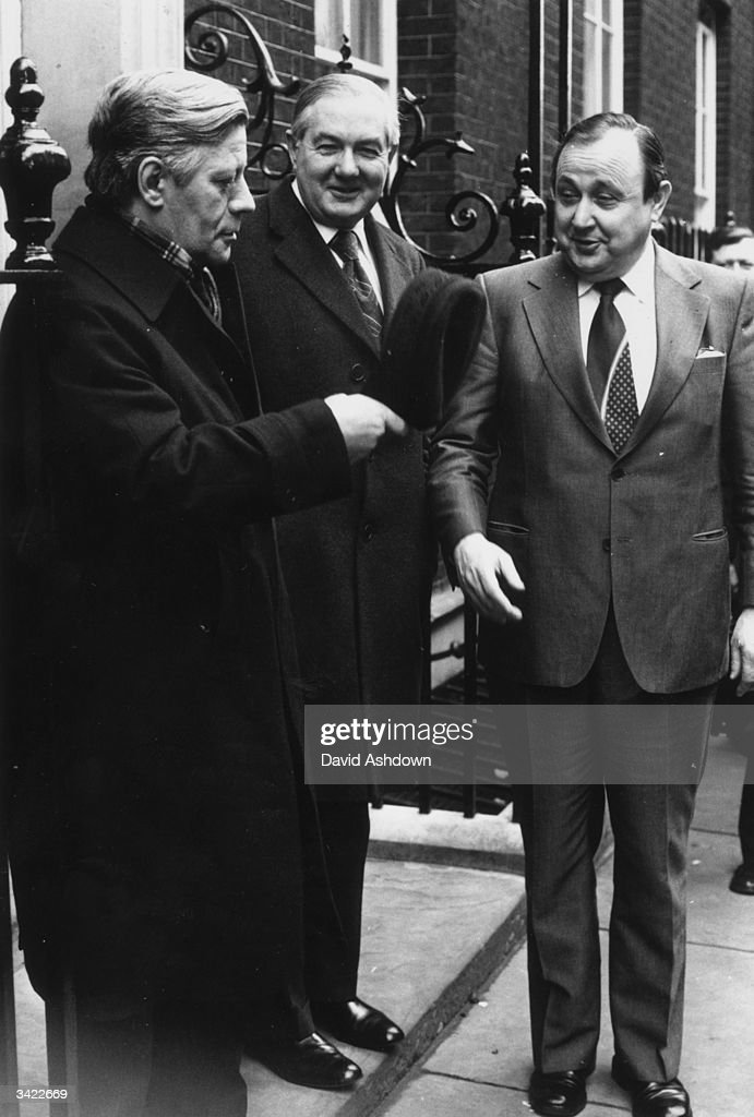 Hans-Dietrich Genscher, the foreign affairs minister stands with Helmut Schmidt, the West German chancellor and Jim Callaghan (1912 - 2005), the British prime minister outside 10 Downing Street.