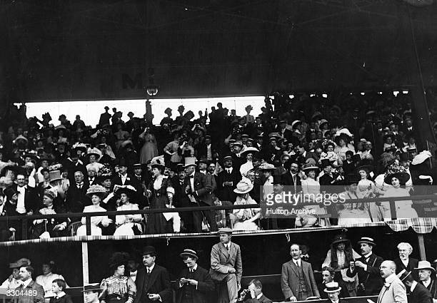 Queen Alexandra watches the finish of the Marathon at the 1908 London Olympics. Despite finishing first, Dorando Pietri of Italy was disqualified for...