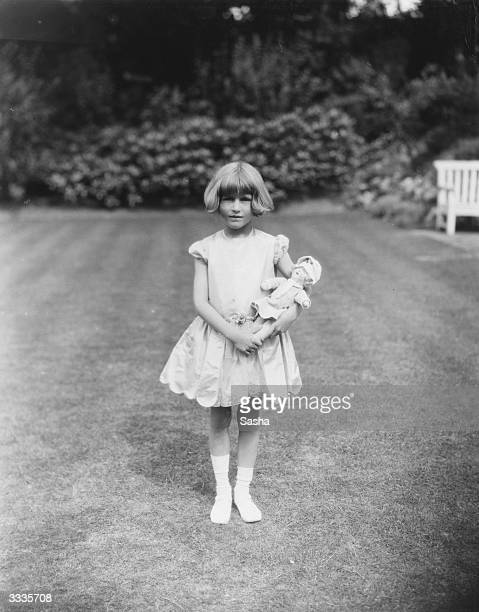 Young Miss Scott Kilvert in the garden with her doll