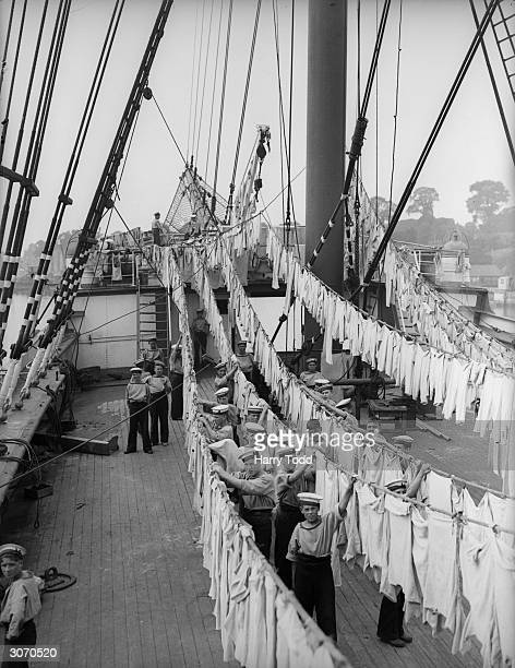 The sailing Ship 'Peking' now renamed 'Arethusa' at berth at Upnor near Rochester on the River Medway Sailor boys springclean in readiness for the...