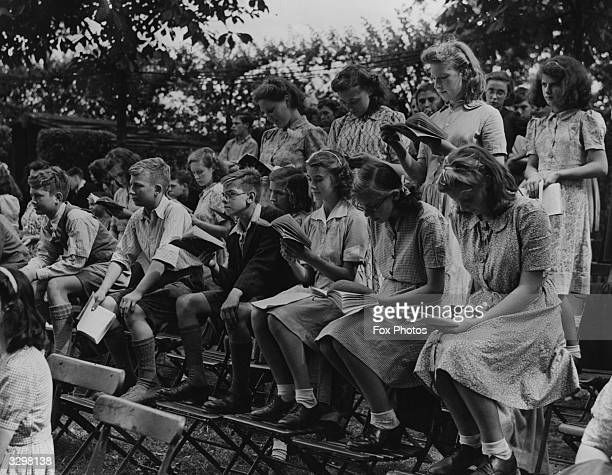 Schoolchildren studying the script of 'A Midsummer Night's Dream' during the first open air television production at Regents Park