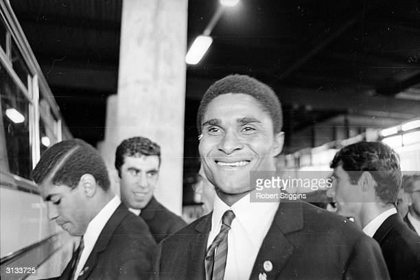 Portuguese footballer Eusebio Ferreira da Silva arrives at Euston Station London He is one of the Portugal team's leading players in the 1966 World...