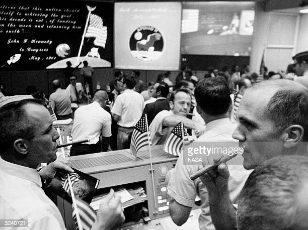 The Mission Operations Control Room in the Mission Control Center Building 30 of NASA's Manned Spacecraft Center in Houston Texas The flight...