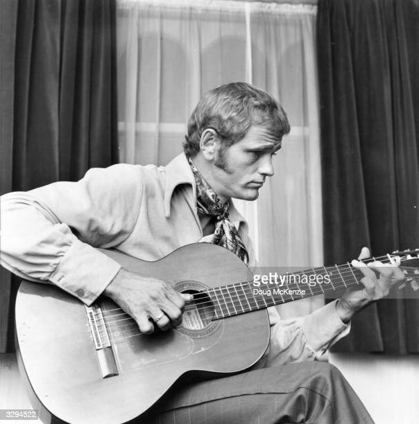 American country guitarist, composer and country-pop singer Jerry Reed , author of the novelty hit 'Rockin' In Baghdad'.