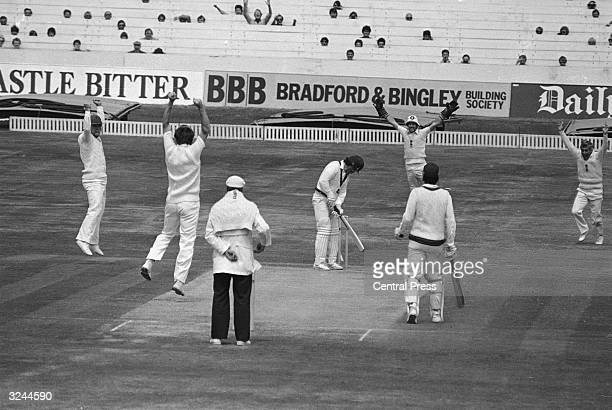 Australian batsman Allan Border is bowled out by England's Chris Old for 0 runs on the last day of the test match
