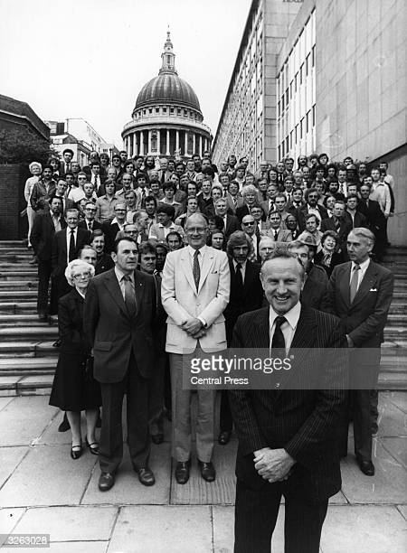 The Chairman of British Telecom, Sir George Jefferson, , with Andrew Gardner, the ITV anchorman and the British Telecomm crew. In the background is...