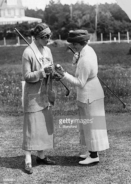 French Ladies Golf Championships at Le Touquet Competitors Miss G Bastin and Mrs Vanderbeck discussing the merits of a ball