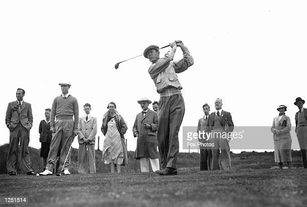 US golfer Byron Nelson competing in a Ryder Cup match at Royal Birkdale Southport Teammate Densmore 'Denny' Shute stands on the left holding a club