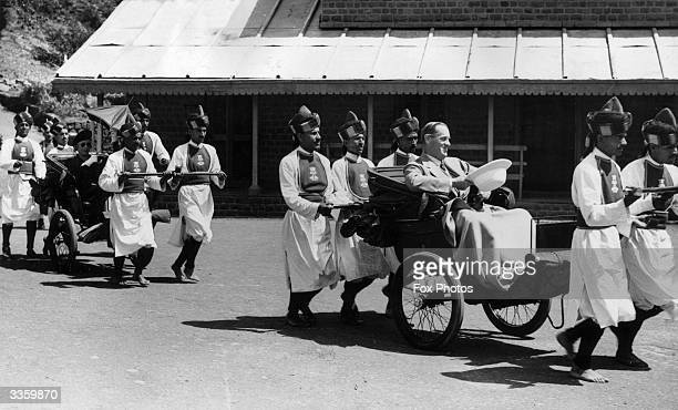 The Viceroy of India Lord Linlithgow with his wife Lady Linlithgow as they are taken by rickshaw to the Pasteur Centre in the Simla Hills in northern...