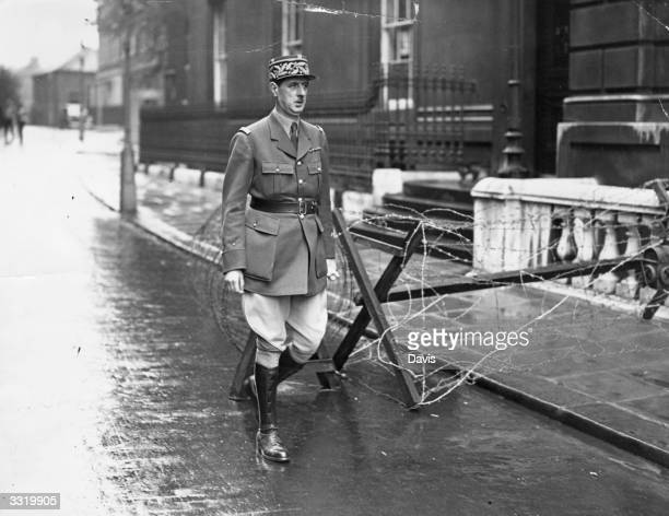 French soldier and politician General Charles De Gaulle leaving Downing Street after discussions on the dramatic broadcast that France and Germany...