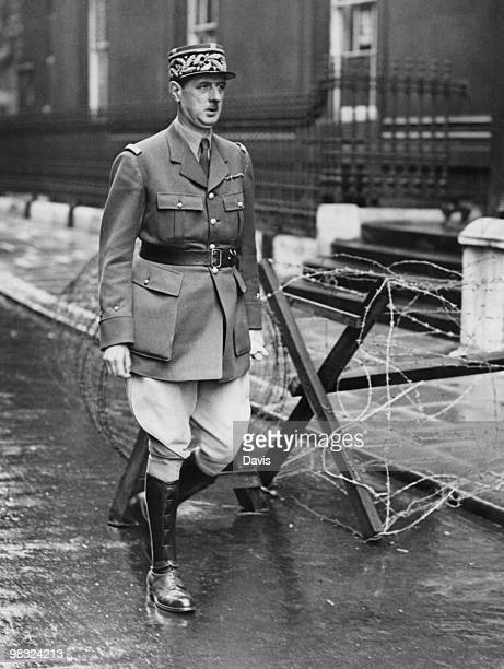 French soldier and politician General Charles de Gaulle leaves Downing Street after discussions on the broadcast that France and Germany had signed...