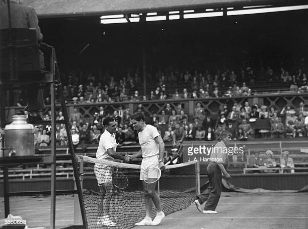 Dinny Pails of Australia is congratulated by Chile's A R Hammersley after winning their opening day match at the Wimbledon Lawn Tennis Championships