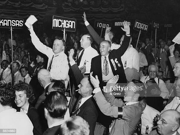 Members of the Michigan delegation at the Republican National Convention in Philadelphia, Pennsylvania, jump to their feet and cheer as Thomas Edward...