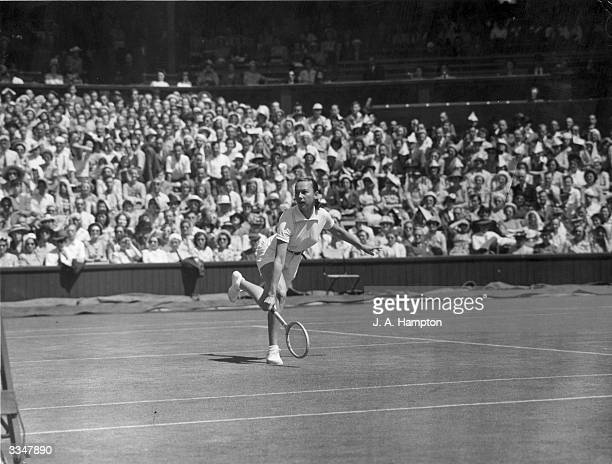 American tennis player Gertrude 'Gussie' Moran in action during her match against G Hoahing on the Centre Court at Wimbledon