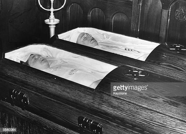 Husband and wife Julius and Ethel Rosenberg lying in their coffins after being executed for spying They were buried at Wellwood cemetery in Long...
