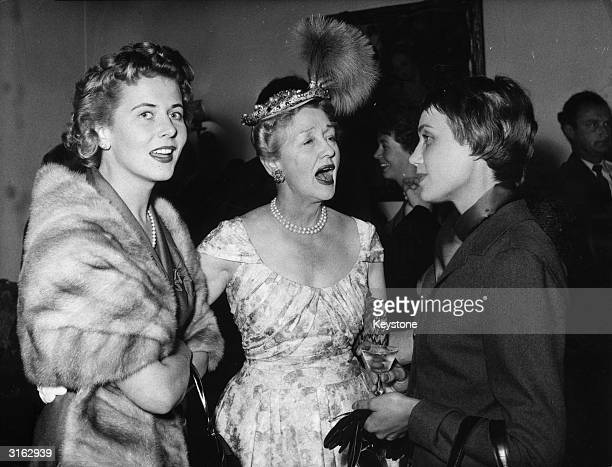 American actress and gossip columnist Hedda Hopper at a party with German film actress Cornell Borchers and Anneliese FriedmannSchuller
