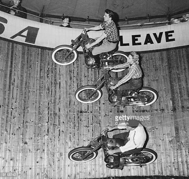 Cindy Willis a Wall of Death rider at Canvey Island flanked by two other riders