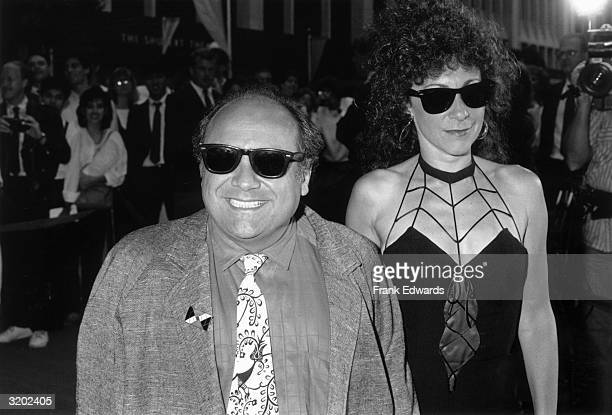 American actor and director Danny DeVito smiles with his wife, actor Rhea Perlman, while attending the premiere of Jim Abrahams and David Zucker's...